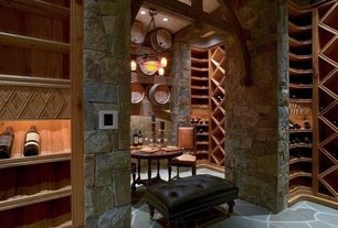 Craftsman Wine Cellar with Exposed beam, slate floors, can lights, Chandelier, High ceiling