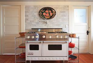 Traditional Kitchen with six panel door, double oven range, Hardwood floors