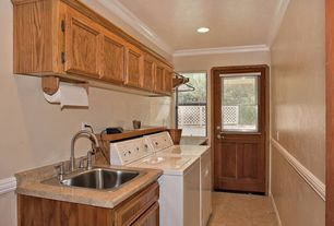 Traditional Laundry Room with laundry sink, drop-in sink, double-hung window, can lights, Concrete tile , Concrete floors