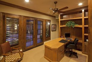 Traditional Home Office with Standard height, Louvered door, can lights, Carpet, Concrete floors, Built-in bookshelf