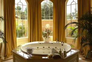 Traditional Master Bathroom with limestone floors, Arched window, Master bathroom