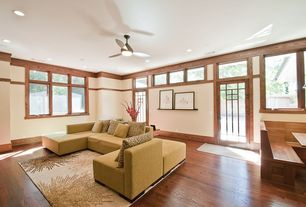 Asian Living Room with Ceiling fan, Transom window, French doors, Hardwood floors, Safavieh Soho Beige Area Rug