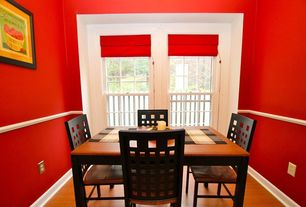 Modern Dining Room with Laminate floors, Chair rail