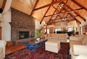 Eclectic Great Room with Ceiling fan, flush light, Hardwood floors, Exposed beam