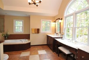 Traditional Master Bathroom with terracotta tile floors, Simple marble counters, Arched window, Wall sconce, Undermount sink