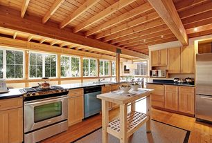 Craftsman Kitchen with Hardwood floors, Undermount sink, can lights, Stone source soap stone, Standard height, Kitchen island