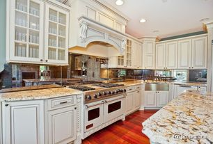 Traditional Kitchen with Raised panel, Marble.com Gold Antique Granite, Stainless Steel, Farmhouse sink, Custom hood