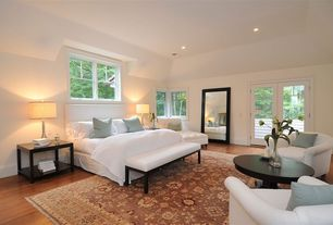 Modern Guest Bedroom with Laminate floors, French doors, Carpet
