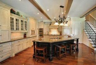 Traditional Kitchen with Crown molding, Kitchen island, full backsplash, Glass panel, Breakfast bar, Simple granite counters
