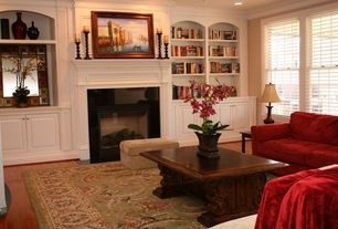 Traditional Living Room with can lights, Laminate floors, double-hung window, Crown molding, Standard height, Carpet