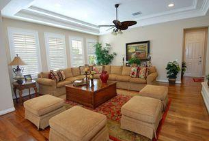 Eclectic Living Room with Laminate floors, can lights, Carpet, Ceiling fan, Standard height, Casement, six panel door