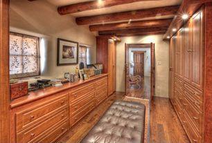 Rustic Closet with Built-in bookshelf, Hardwood floors, Exposed beam, French doors