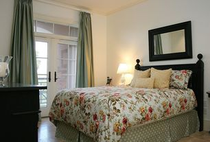 Traditional Guest Bedroom with picture window, Crown molding, Transom window, French doors, Concrete tile , Standard height
