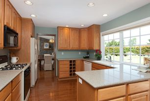 Traditional Kitchen with Hardwood floors, Casement, Standard height, dishwasher, Raised panel, drop-in sink, can lights