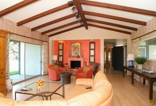 Eclectic Living Room with sliding glass door, Cement fireplace, flush light, Standard height, Exposed beam, Fireplace