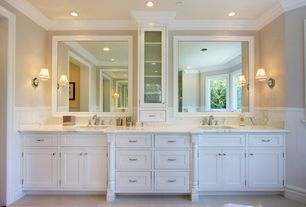 Traditional Master Bathroom with Glass panel, Wall sconce, stone tile floors, can lights, Glass panel cabinets, Casement