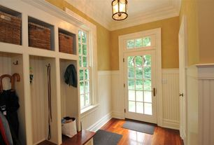 Traditional Mud Room with Transom window, French doors, Laminate floors, Wainscotting, flush light, Built-in bookshelf