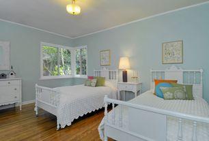 Cottage Guest Bedroom with flush light, Hardwood floors, Crown molding