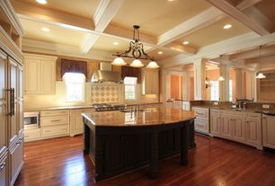Traditional Kitchen with built-in microwave, Laminate floors, Large Ceramic Tile, Wall Hood, Chandelier, Raised panel
