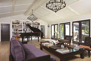 Contemporary Living Room with French doors, Wall sconce, Hardwood floors, Exposed beam, Barn door, Built-in bookshelf