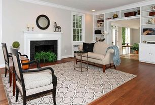 Traditional Living Room with Fireplace, Standard height, Built-in bookshelf, can lights, Crown molding, stone fireplace