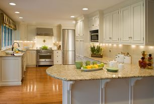 Traditional Kitchen with Wall Hood, Large Ceramic Tile, dishwasher, Simple granite counters, can lights, Raised panel