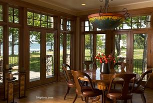 Traditional Dining Room with Paint 1, Crown molding, picture window, Transom window, Laminate floors, can lights, flush light