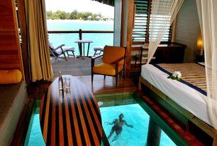 Tropical Master Bedroom with Casement, Standard height, Balcony, French doors, Hardwood floors