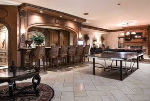 Traditional Game Room with Crown molding, Chandelier, metal fireplace, limestone tile floors