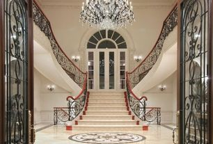 Eclectic Staircase with Hardwood floors, High ceiling, Wall sconce, Wainscotting, French doors, Chandelier, Arched window