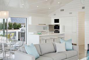 Contemporary Great Room with Chandelier, Built-in bookshelf, can lights, Concrete tile , sliding glass door, Standard height