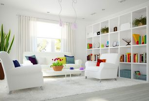 Contemporary Living Room with Built-in bookshelf, Pendant light, Hardwood floors