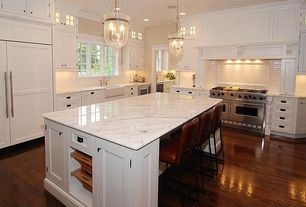 Traditional Kitchen with can lights, Flat panel cabinets, Framed Partial Panel, Complex marble counters, Kitchen island