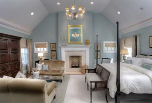 Traditional Master Bedroom with Paint 1, double-hung window, can lights, Chandelier, Paint 2, Cement fireplace, Fireplace