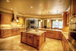 Traditional Kitchen with Stone Tile, Crown molding, Kitchen island, U-shaped, Raised panel, Undermount sink, Limestone Tile