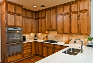 Craftsman Kitchen with Multiple Sinks, double wall oven, warming oven, Stone Tile, U-shaped, Simple marble counters, Flush