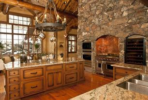 Rustic Kitchen with full backsplash, double oven range, Wine refrigerator, Pendant light, Breakfast bar, Flush, Custom hood