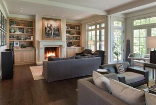 Contemporary Living Room with Fireplace, Hardwood floors, can lights, Exposed beam, French doors, Transom window
