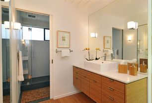 Contemporary 3/4 Bathroom with Corian counters, frameless showerdoor, Laminate floors, Vessel sink, Flush, European Cabinets