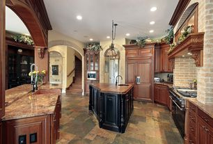 Traditional Kitchen with Kitchen island, U-shaped, slate tile floors, Undermount sink, Glass panel, Onyx counters, Stone Tile