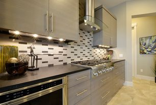 Contemporary Kitchen with Arieta stainless and glass wall hood, Led under cabinet lighting, Under counter wall oven