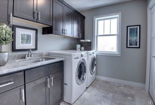 Traditional Laundry Room with specialty door, Undermount sink, laundry sink, Standard height, Paint, travertine floors