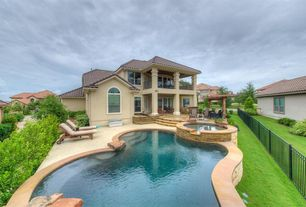 Mediterranean Swimming Pool with Arched window, Pool with hot tub, Outdoor kitchen, exterior stone floors, Trellis, Fence