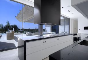 Contemporary Kitchen with Waterfall countertop, can lights, Solid surface countertop, Undermount sink, picture window, Flush