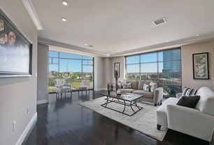 Contemporary Living Room with Standard height, Hardwood floors, can lights, Crown molding