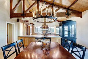 Rustic Dining Room with Chandelier, sandstone floors, Exposed beam, High ceiling