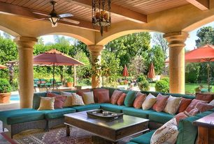 Mediterranean Porch with exterior tile floors, Wrap around porch, Raised beds