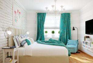 Contemporary Guest Bedroom with Crown molding, Hardwood floors, interior brick, Chandelier, dCOR design Amelie Platform Bed