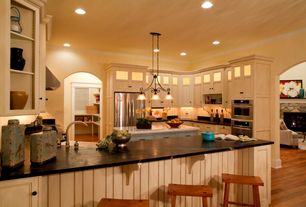 Country Kitchen with Glass panel, Soapstone counters, Breakfast bar, Flat panel cabinets, U-shaped, Crown molding, Soapstone