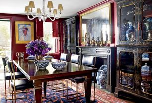 Traditional Dining Room with Hardwood floors, stone fireplace, Chandelier, Crown molding, Dutch door